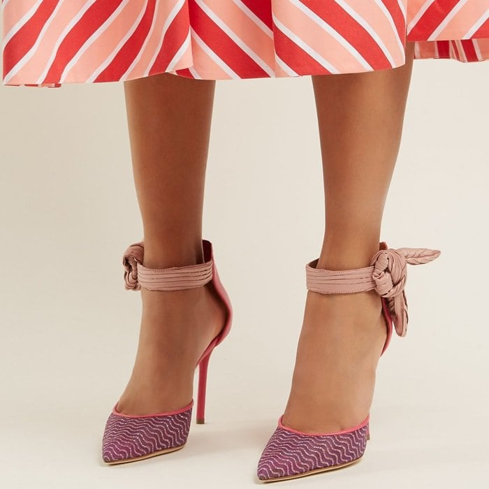 These pink pumpsfeature metallic waves across the pointed toes