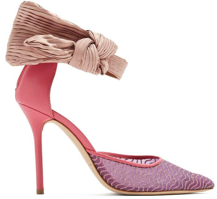 These pink pumps feature metallic waves across the pointed toes, hot-pink piped edge trim, and a dramatic pleated-bow ankle strap