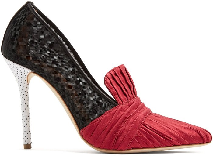These shoes feature black polka dot-flecked mesh side panels and a high stiletto heel