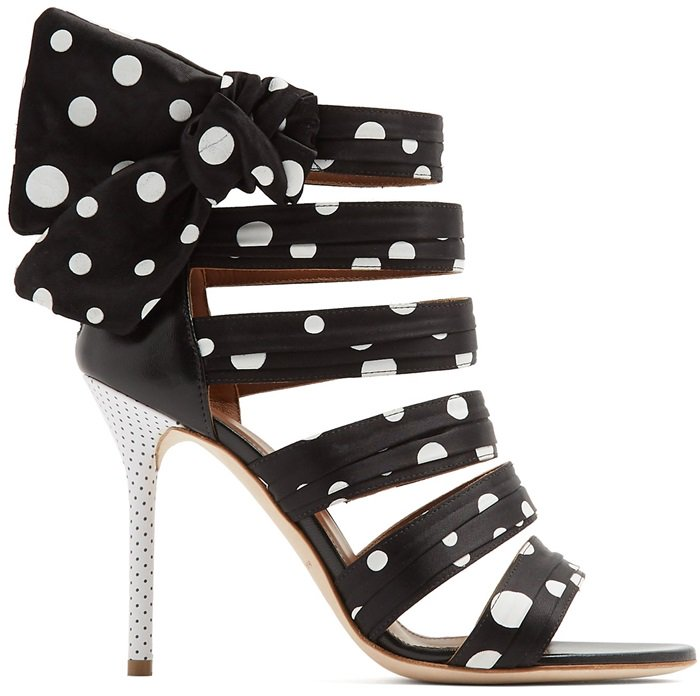 A daintier version decorates the white leather-covered stiletto heels