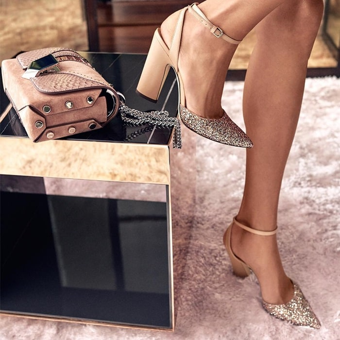 Jimmy Choo's Micky sandals have a glitter-coated upper that is subtly contrasted against patent leather ankle straps