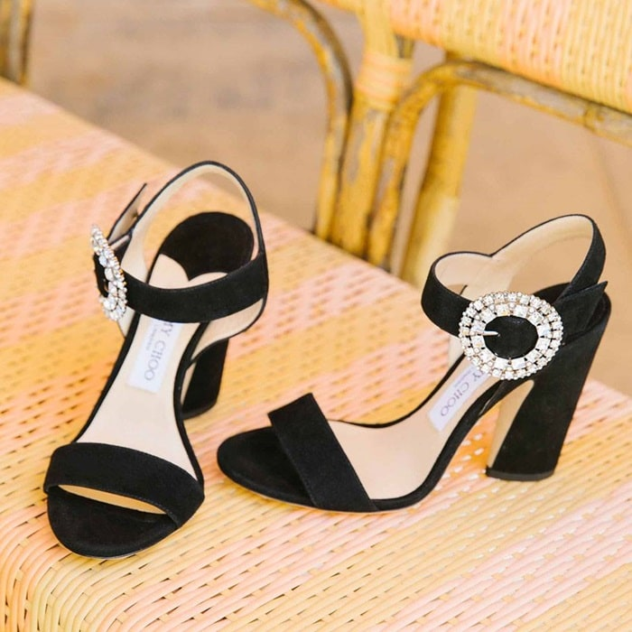 78f69b259a16 A dazzling crystal buckle brings showstopping glamour to a statement sandal  crafted from buttery suede and