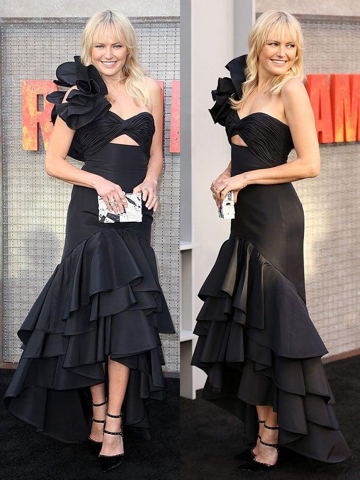 Malin Akerman carrying an Emm Kuo clutch and wearing a Johanna Ortiz ruffled dress with Le Silla 'Borgia' pumps
