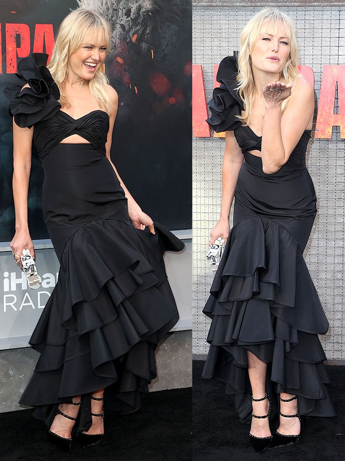 Malin Akerman playing with her Johanna Ortiz dress and blowing kisses