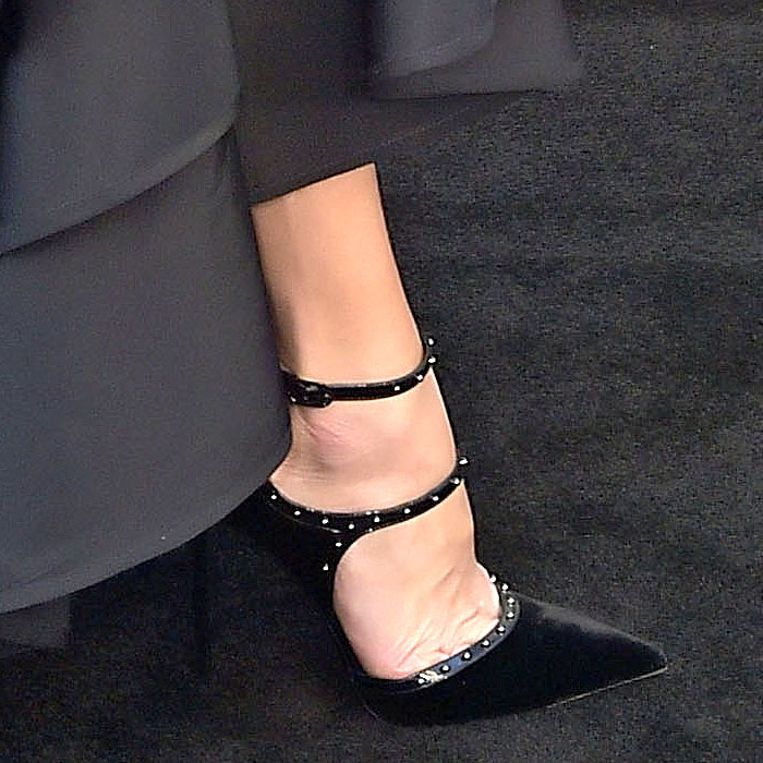 Closeup of the Le Silla 'Borgia' studded-strap black velvet pumps on Malin Akerman.