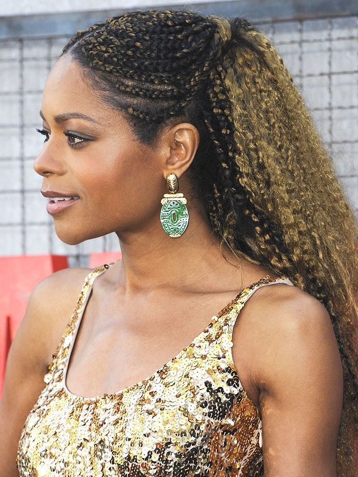 Details of Naomie Harris' David Webb gold-and-jade earrings.