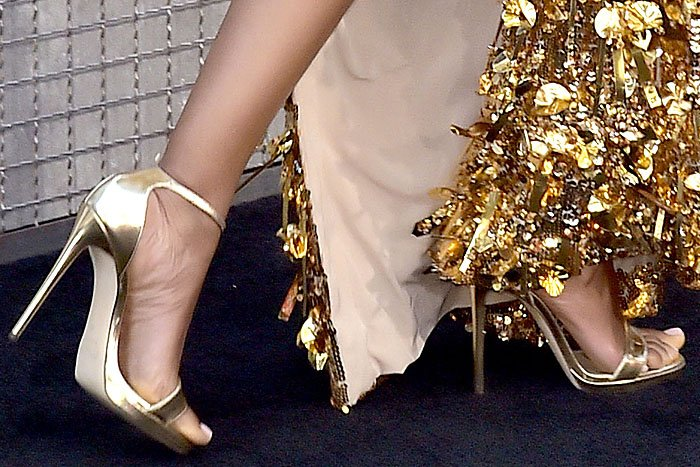Details of Naomie Harris' Jimmy Choo metallic-gold ankle-strap sandals.