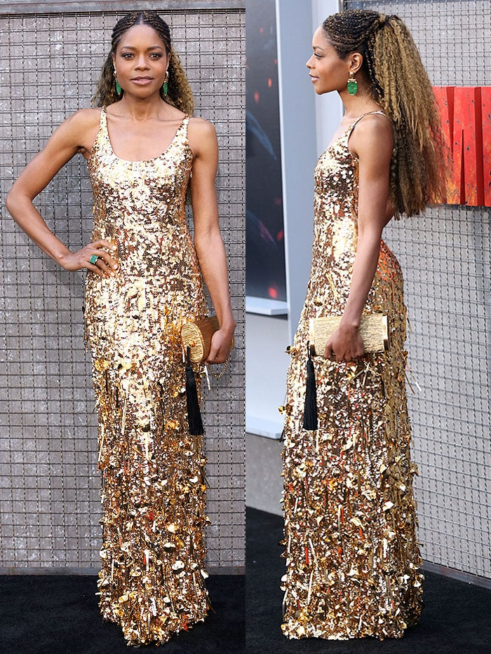 Naomie Harris with blond-hued cornrows in a Miu Miu gold sequined dress