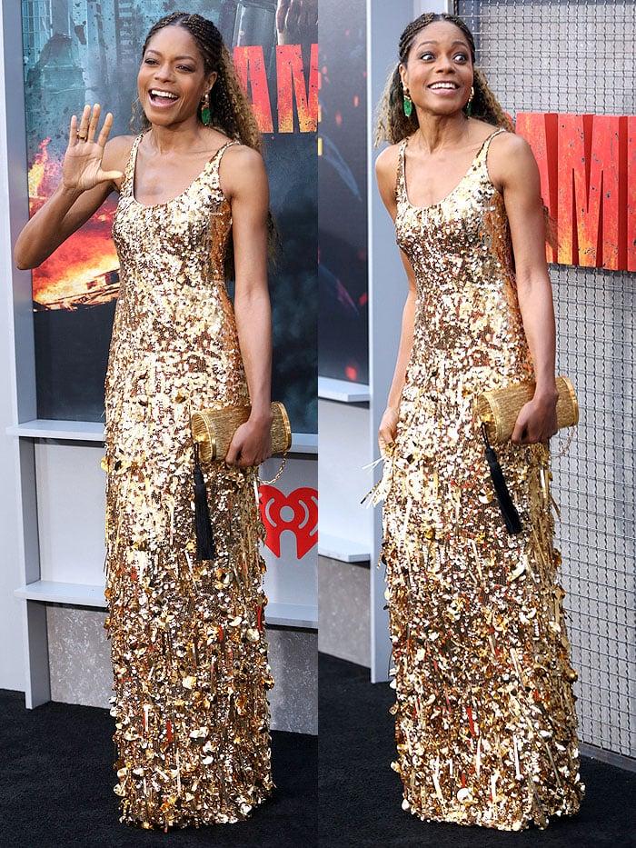"Naomie Harris in a gold Miu Miu dress at the ""Rampage"" LA premiere."
