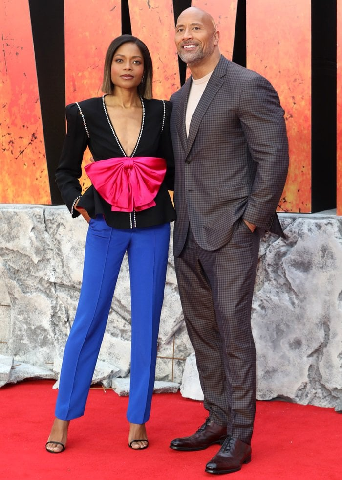 """Naomie Harris and Dwayne """"The Rock"""" Johnson on the red carpet at the European premiere of their anticipated film 'Rampage'"""