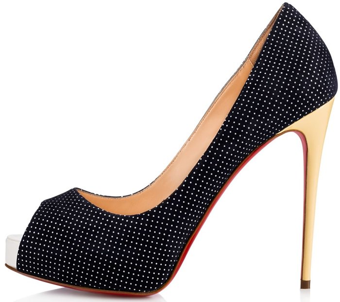 This peep-toe pump in navy and white polka dot suede makes a charming statement