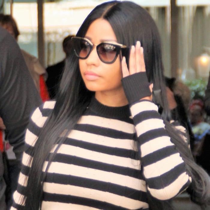Nicki Minaj is seen leaving her hotel for Roissy Charles de Gaulle airport in Paris, France, on April 5, 2018