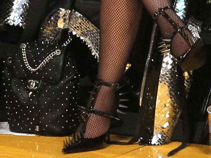 Details of Nicki Minaj's Chanel studded leather backpack and Balenciaga 'Knife' spiked t-strap pumps.