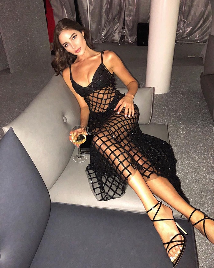 Olivia Culpo's Instagram post of her wearing aCalzedonia sheer netted dress with Gianvito Rossi 'Kim' sandals.