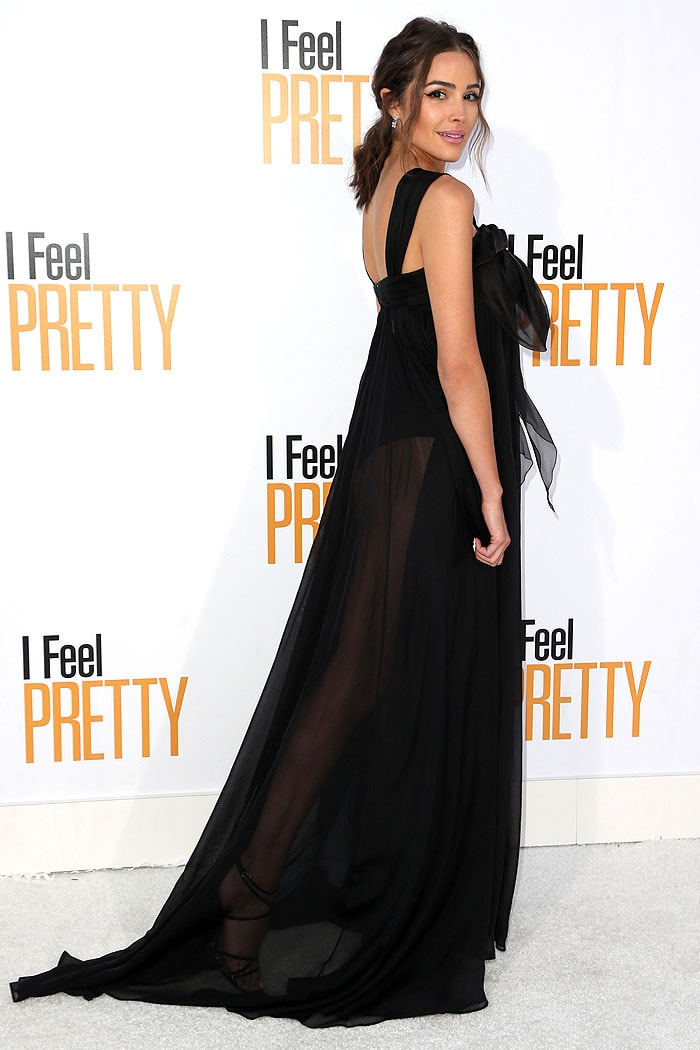 Olivia Culpo showing leg in a Olivia Culpoin an Ester Abner Spring 2018 sheer black gown.