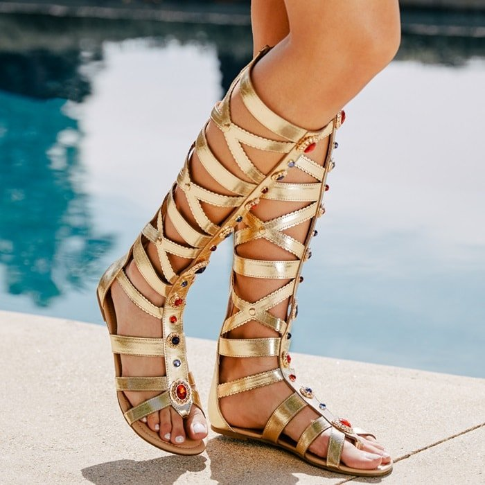 Knee-high jeweled flat gladiator sandal with thong post, scalloped detailing, and functional back zip