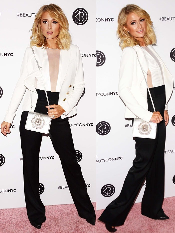 Paris Hilton in a Galvan tuxedo plunge jumpsuit and Tom Ford metal-heel black-leather pumps.