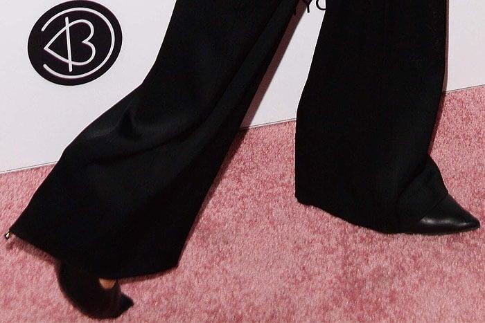 Tom Ford gold-heel black-leather pumps on Paris Hilton.