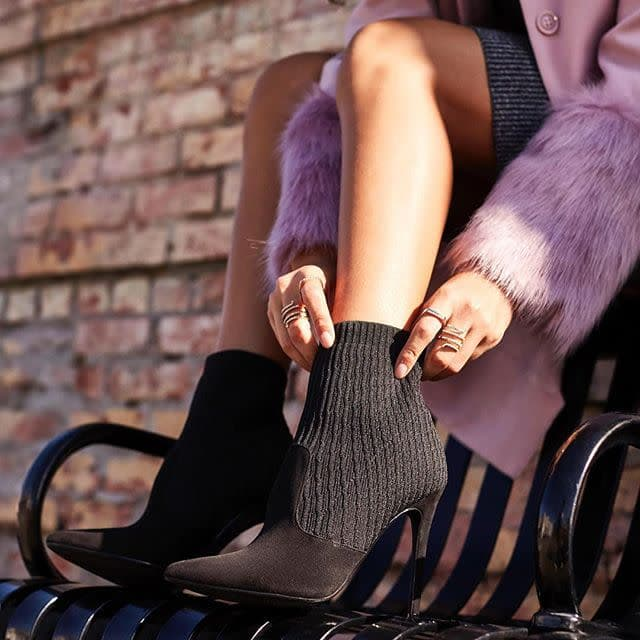 A chic black sock bootie with a faux suede and knit construction and a stiletto heel