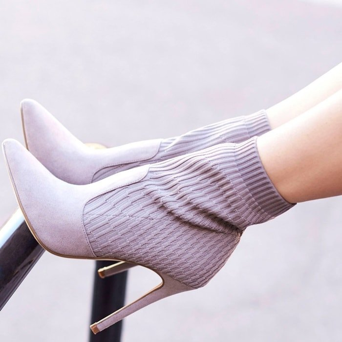 A chic gray sock bootie with a faux suede and knit construction and a stiletto heel