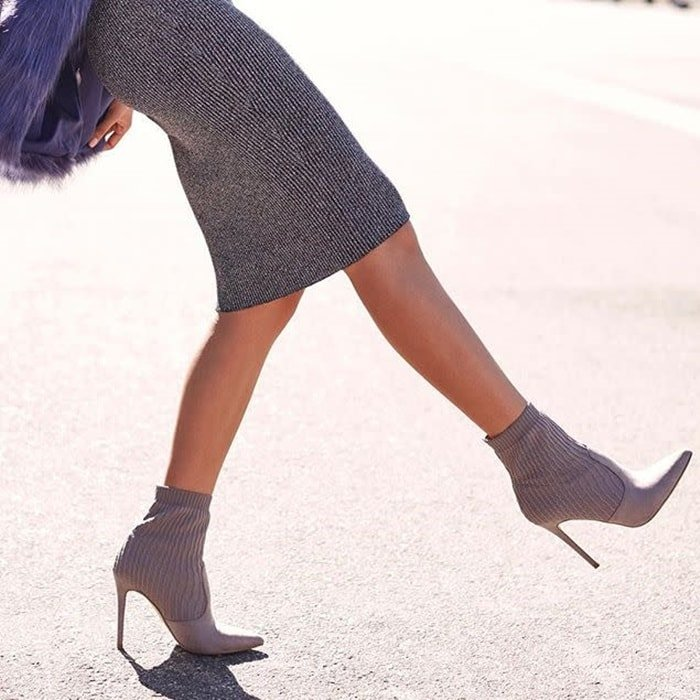 Sock bootie with a faux suede and knit construction and a stiletto heel