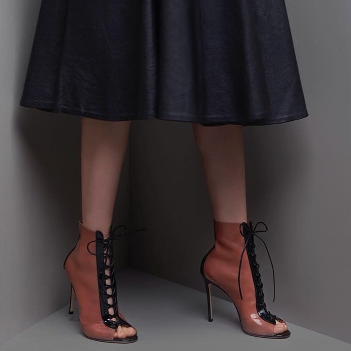 This edgy, leg-lengthening design is finished with a patent-leather-covered stiletto heel