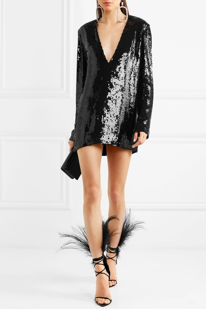 Model wearing a sequined tulle mini dress by Saint Laurent