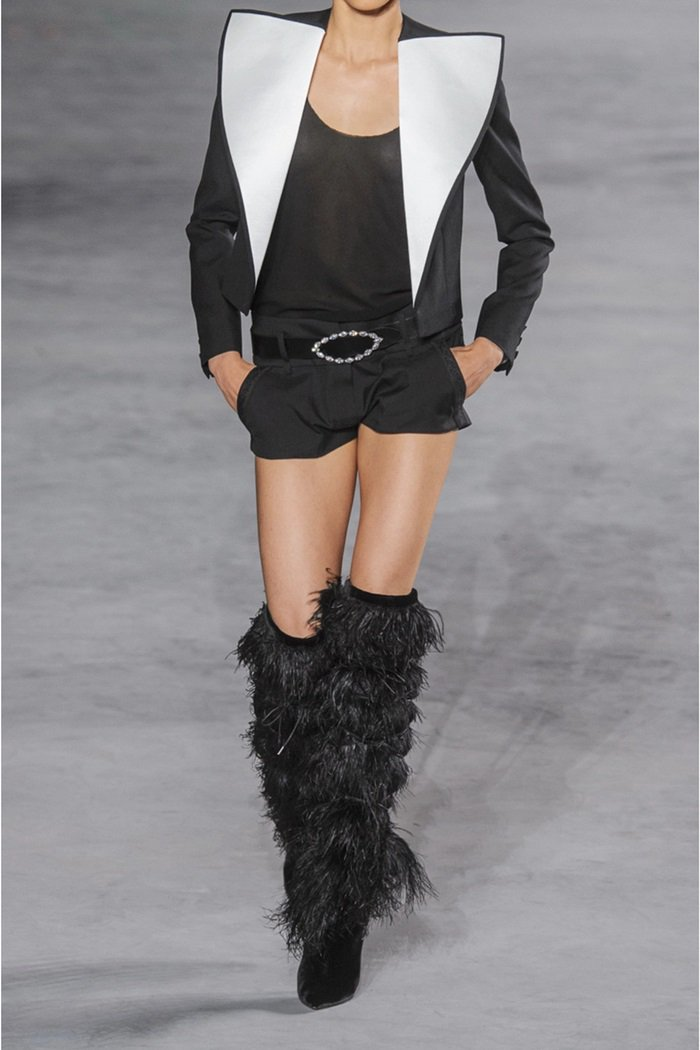 A hero piece from the show, these suede 'Yeti' boots are tiered with swathes of floaty ostrich feathers