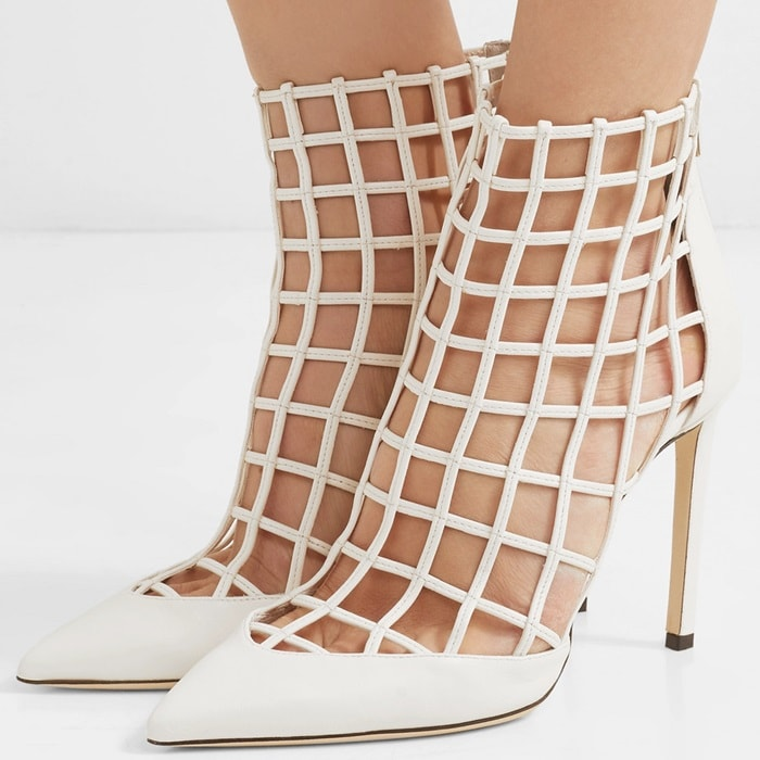 Crafted from white leather, they have a caged cutout upper and sleek, pointed toe