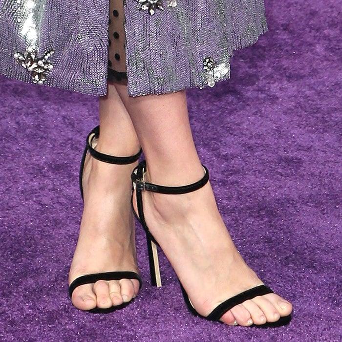 Closeup ofScarlett Johansson's black velvet Jimmy Choo 'Minny' sandals.