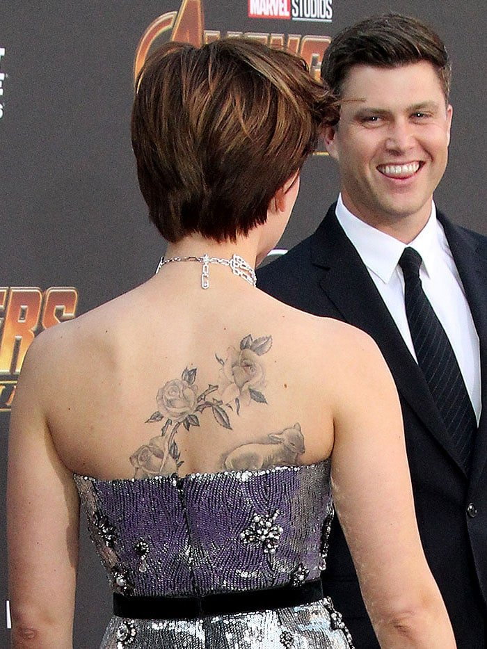 Scarlett Johansson showing her roses and lamb back tattoo.