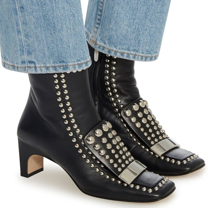 This SR1 ankle boot is rendered in nappa and features all over studded embellishments and a square toe