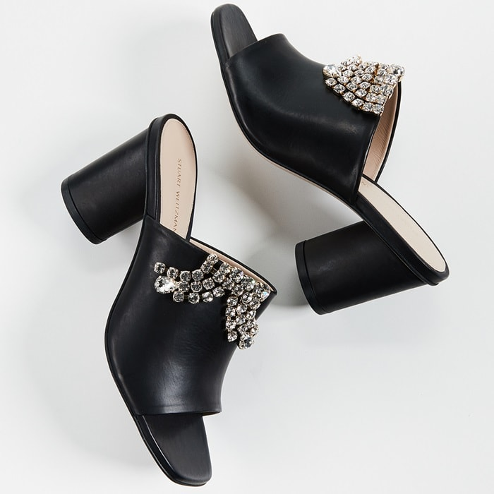These streamlined sandals from Stuart Weitzman are crafted from nappa, high-shine leather