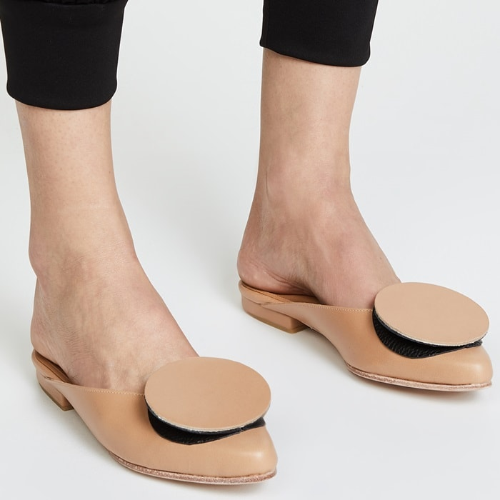 A minimalist pair of Palatines mules promises to provide a little originality with even more luxury in smooth leather that will pair with any ensemble from casual to bridal