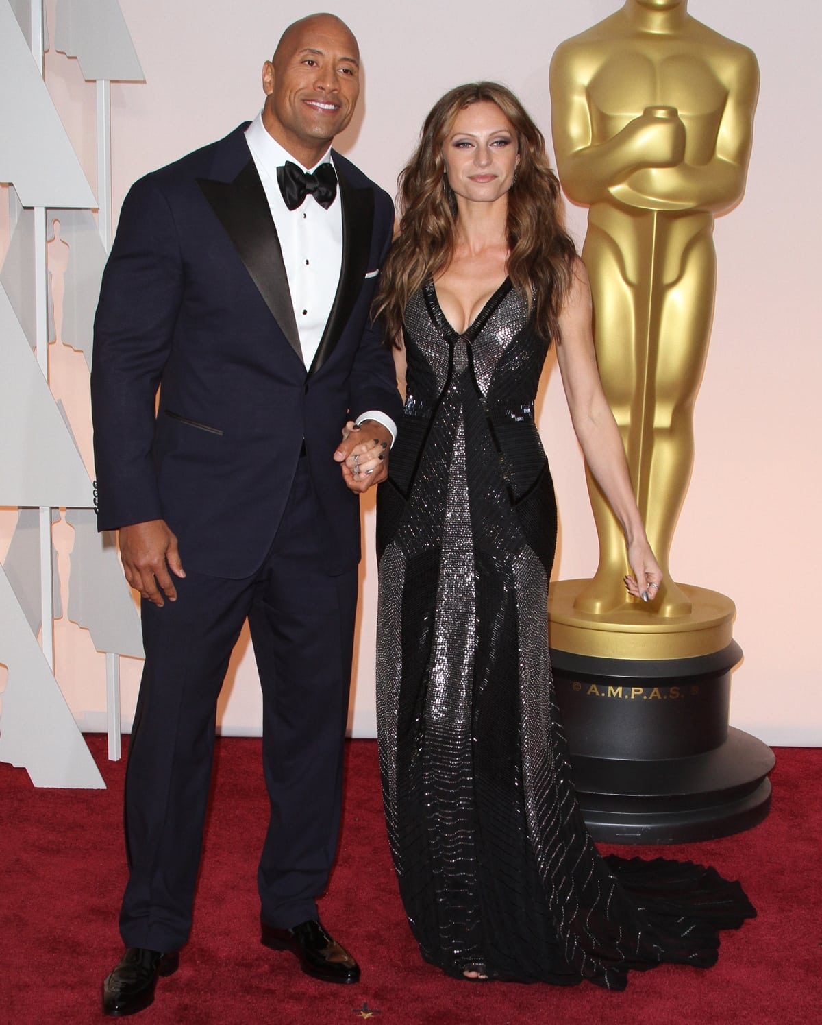"""Dwayne """"The Rock"""" Johnson with his girlfriend Lauren Hashian at the 2015 Academy Awards"""