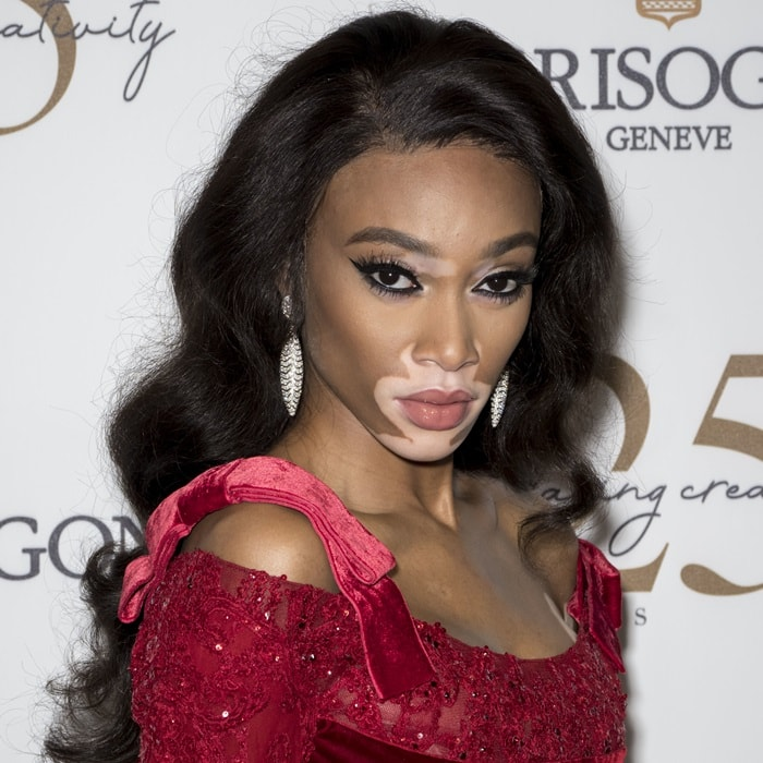 Winnie Harlow in a breathtaking red embellished peplum gown from Elie Saab