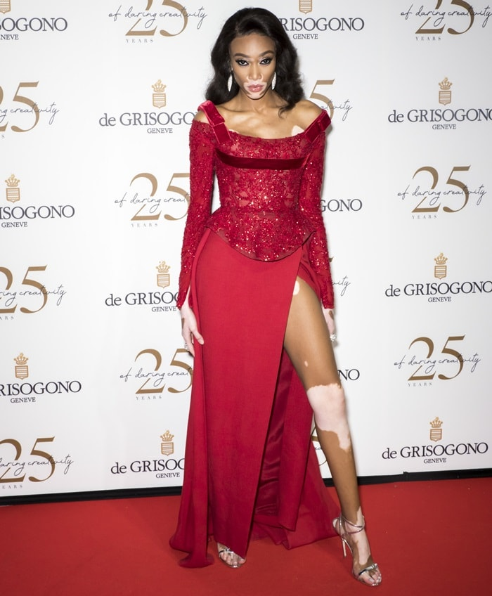 Winnie Harlow wearingsilver strappy 'Ellie' sandals with dual crystals