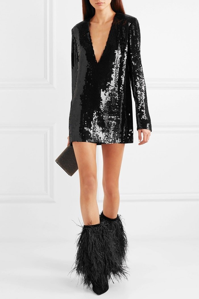 Model wearing Yeti feather-trimmed velvet boots witha sequined tulle mini dress