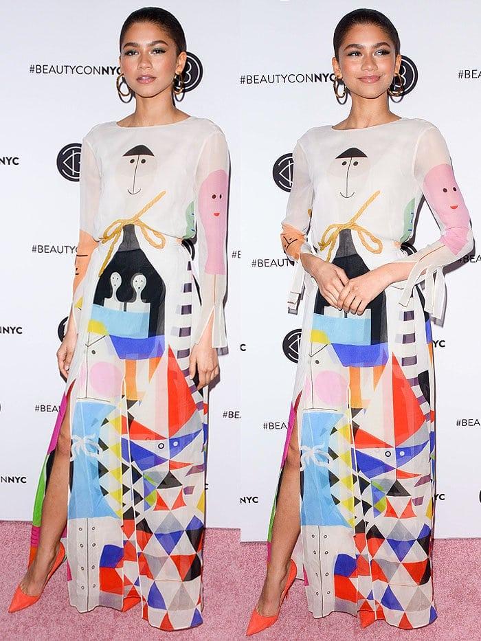 Zendaya in anAkris Spring 2018 art-print long-sleeved dress and Christian Louboutin 'So Kate' orange suede pumps.