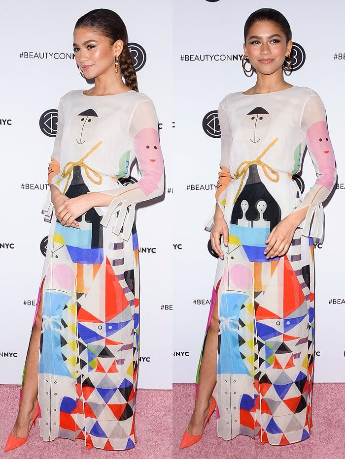 Zendaya in an art-print long-sleeved dress and Christian Louboutin 'So Kate' orange suede pumps.