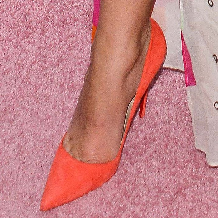 Closeup of Zendaya's orange suede Christian Louboutin 'So Kate' pumps.