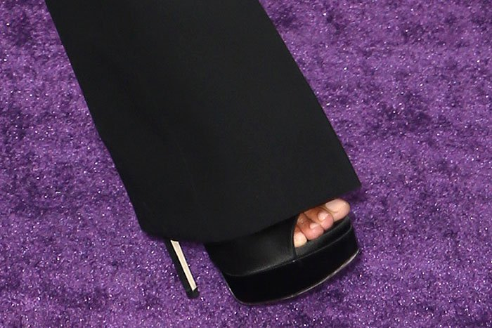 Zoe Saldana's Jimmy Choo 'Max' platform sandals in black satin up close.