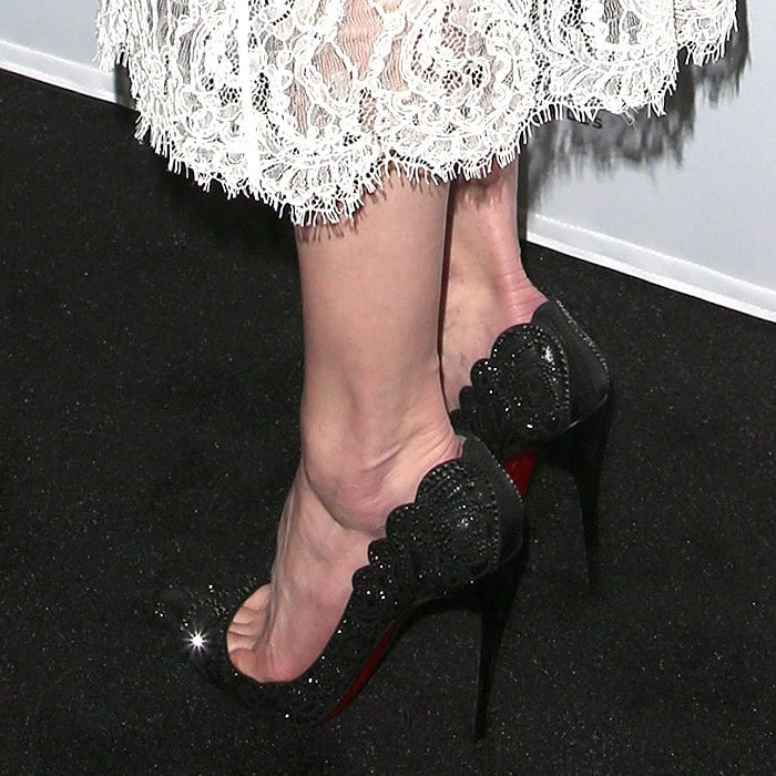 Details of Amber Heard's Christian Louboutin 'Top Vague' black-leather pumps studded with black crystals.