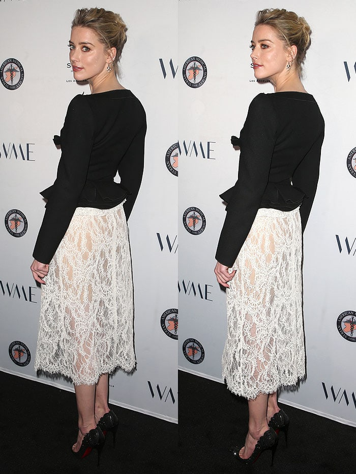 Amber Heard baring her bum in a see-through Brock Collection white-lace skirt.