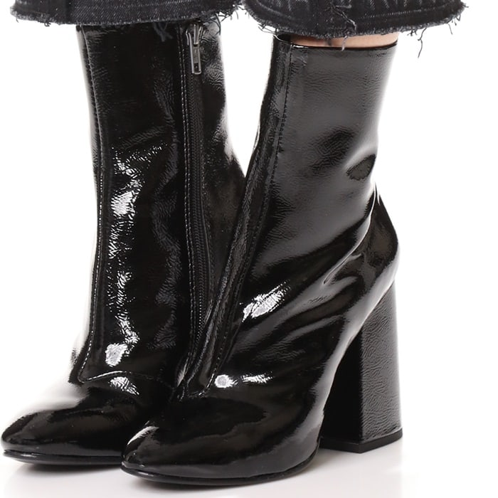 Block-heeled leather ankle boots in a glossy patent finish add slick polish to your everyday ensemble