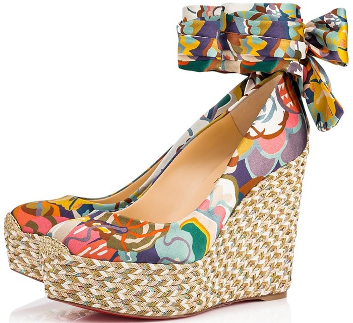 An elegant wide satin bow at the ankle and finely braided esparto rope outsole with shiny threads dress these espadrilles