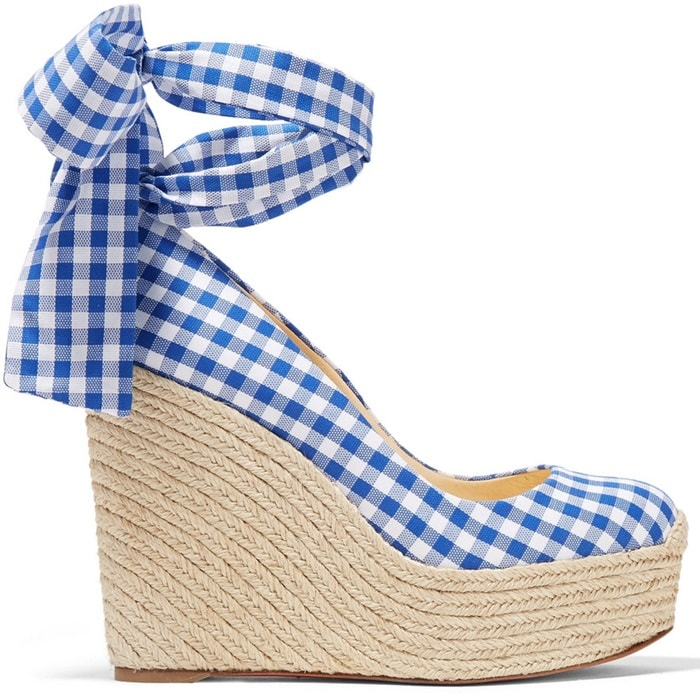 This retro check espadrille pair is made from canvas and has matching ties that elegantly wrap around your ankle