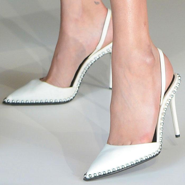 Bella Hadid's feet in white Alexander Wang 'Rina' slingback pumps.