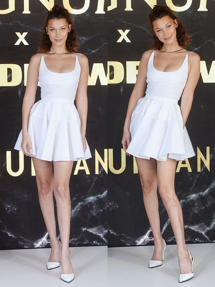 Bella Hadid wearing a white flared dress with at Alexander Wang 'Rina' slingback pumps.
