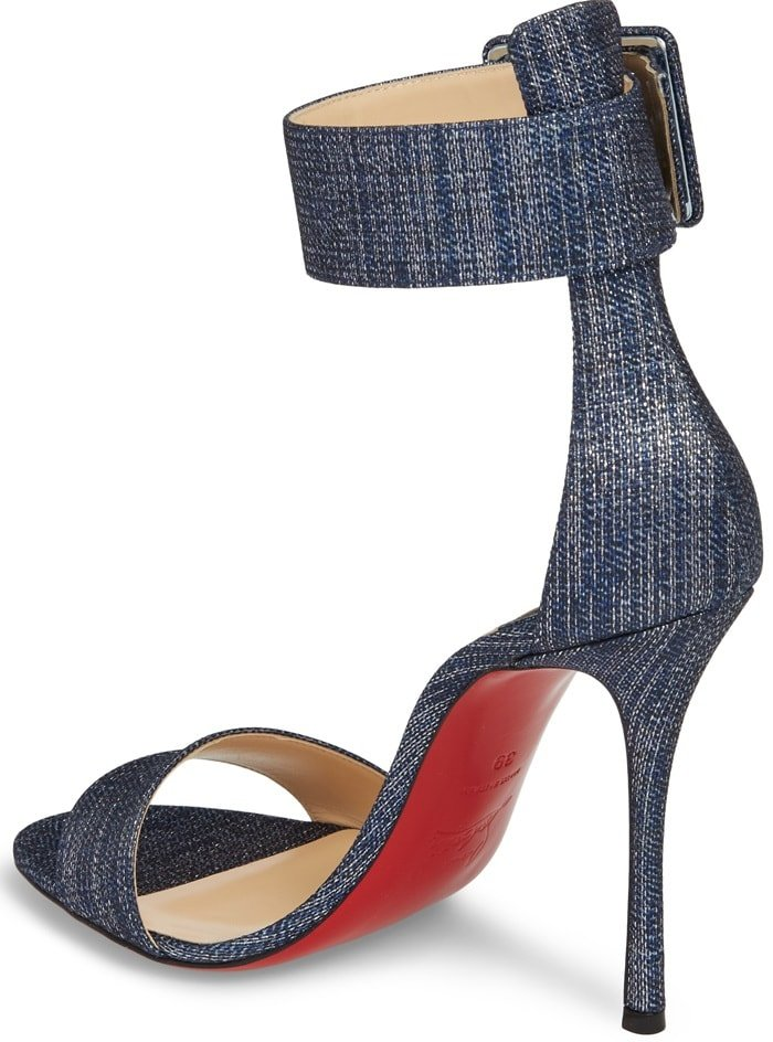 A geo-buckled ankle cuff and a curvy Cuban heel further the provocative appeal of a barely-there sandal lofted high on an impossibly slender stiletto.